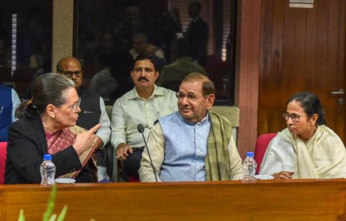 Senior Congress leader Sonia Gandhi, Loktantrik Janta Dal leader Sharad Yadav and West Bengal Chief Minister Mamata during the Opposition parties' meet at Parliament House complex, in New Delhi on Wednesday. (PTI Photo)