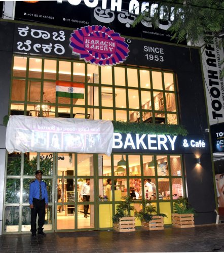 Karachi Bakery was forced to cover its signboard on February 22. DH FILE PHOTO