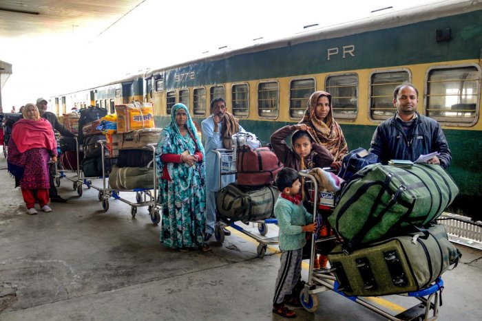 Passengers, arriving from Pakistan by Samjhauta Express train, wait for custom-check at Attari railway station, near Amritsar on Monday. (PTI Photo)