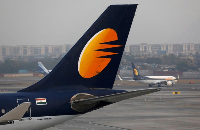 FILE PHOTO: A Jet Airways plane is parked as another moves to a runway at the Chhatrapati Shivaji International airport in Mumbai. REUTERS