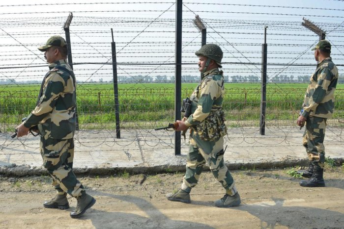 Border Security Force personnel walk along a fence at the India-Pakistan border on the outskirts of Amritsar on February 27, 2019. AFP