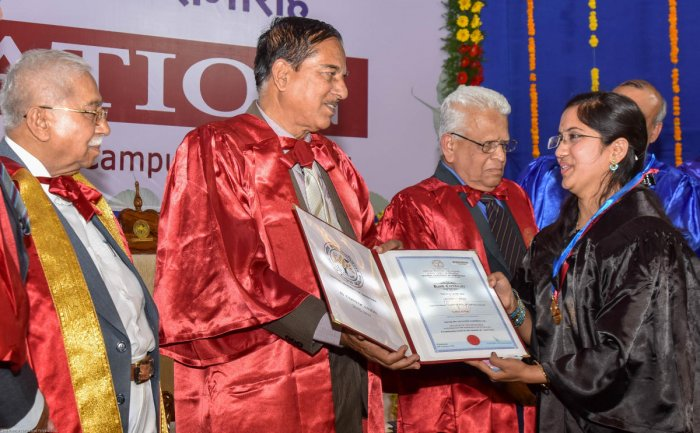 Apoorva Joshi recieves two gold medals and a degree certificate for MTech (Information & Communiction Technology) from Vice Chancellor Prof H M Maheshwaraiah at the 4th Convocation of Karnataka Central University in Kalaburagi on Thursday. President o