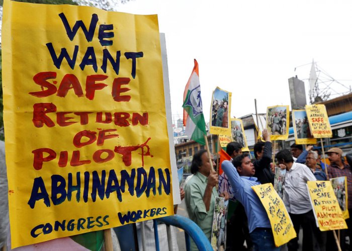 Demonstrators hold placards and shout slogans in Kolkata during a protest demanding the release of an Indian Air Force pilot after he was captured by Pakistan. (Reuters Photo)