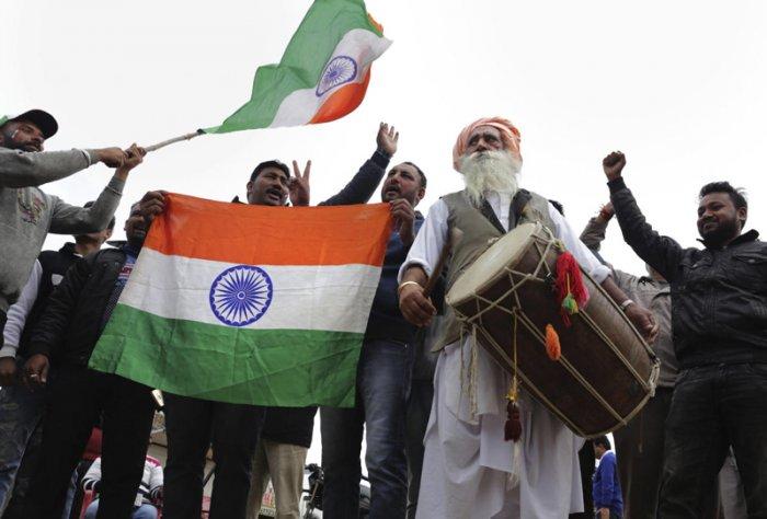 People celebrate ahead of Abhinandan Varthaman's return to India. PTI photo.