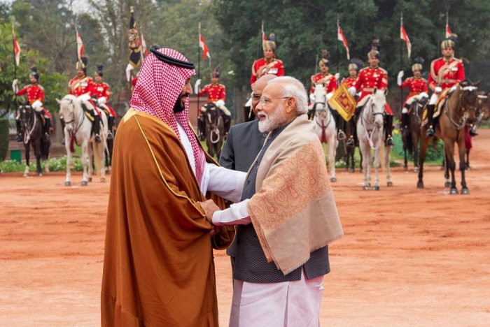 Prime Minister Narendra Modi (R) greeting Saudi Arabia's Crown Prince Mohammed bin Salman (L) during a ceremonial reception at presidential palace in New Delhi on February 20, 2019. AFP/SAUDI ROYAL PALACE/BANDAR AL-JALOUD