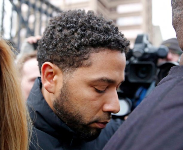 Jussie Smollett leaves Cook County jail after posting bond on February 21, 2019 in Chicago. - Smollett, whom police have accused of orchestrating a bogus assault for personal gain, is being removed from the final two episodes of this season of the TV show