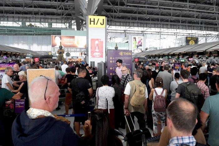 Stranded passengers wait at the check-in area at the Suvarnabhumi International Airport in Bangkok. (AFP Photo)