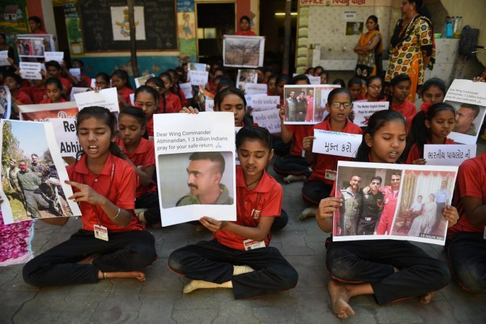 """students pray for a speedy release of Indian Air Force pilot Abhinandan Varthaman, in a school in Ahmedabad on February 28, 2019. - Pakistan said on February 28 it will release a captured Indian pilot in a """"peace gesture"""", taking a step towards rapprochement as clashes between the nuclear-armed rivals ignited fears of a disastrous conflict. (AFP photo)"""