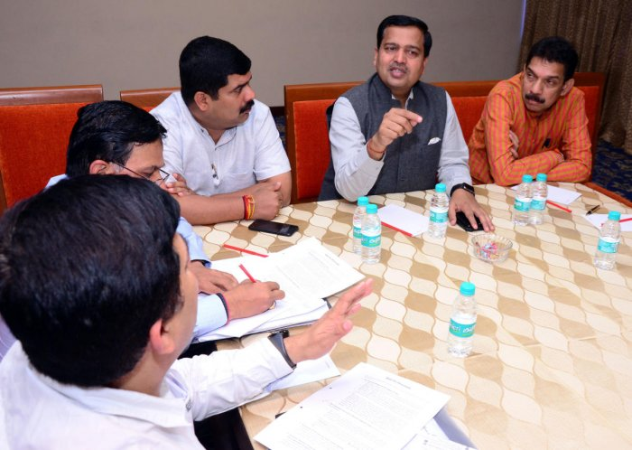 Vaibhav Dange, secretary to Union Minister for Road Transport, Highways and Shipping Nitin Gadkari, presides over a meeting with Navyug company and NHAI officials at Taj Gateway Hotel on Thursday, set a strict deadline for completion of flyovers in Thokko