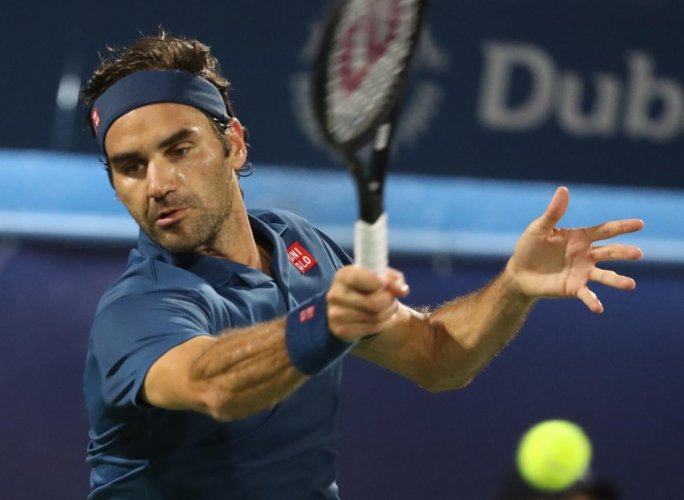 CLASSY: Swiss great Roger Federer returns during his win over Hungarian Marton Fucsovics. AFP