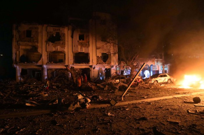 Flames are burning at the scene where a suicide car bomb exploded targeting a Mogadishu hotel in a business center in Maka Al Mukaram street in Mogadishu, Somalia. February 28, 2019. REUTERS/Feisal Omar TPX IMAGES OF THE DAY