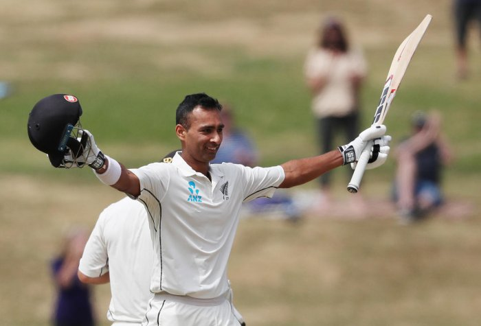 MAIDEN TON New Zealand's Jeet Raval celebrates his century on the second day of the first Test against Bangladesh in Hamilton on Friday. AFP