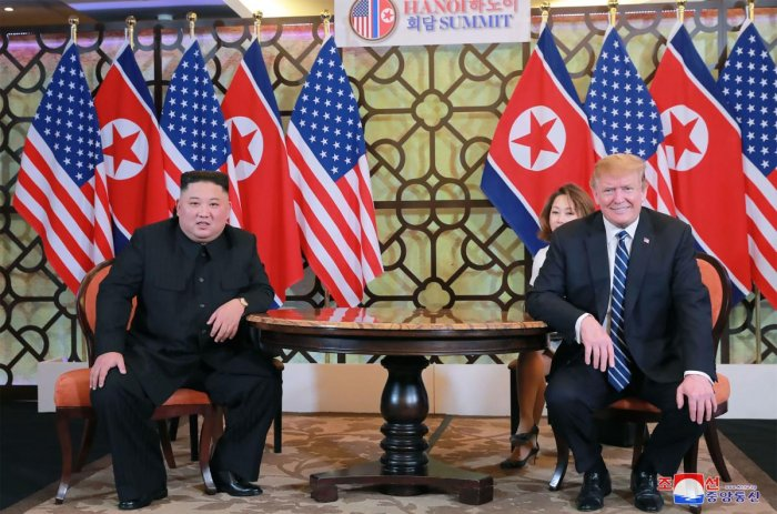 This picture from North Korea's official Korean Central News Agency (KCNA) taken on February 28, 2019 and released on March 1, 2019 shows North Korean leader Kim Jong Un (L) sitting with US President Donald Trump at the Sofitel Legend Metropole hotel in H