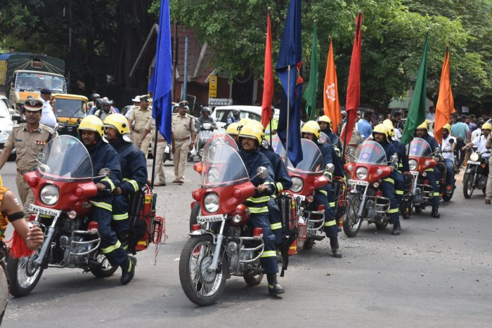 Fire men, Karnataka Civil Defence Corps and other civilians participated in Walkathon, to create awareness on Fire accidents as the part of National Fire Service Week, organised by Karnataka State Fire and Emergency Services starts at Cubbon Park to KSFES