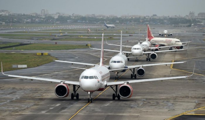 Aircraft queue up on the tarmac before take off at the Mumbai airport. (AFP File Photo)