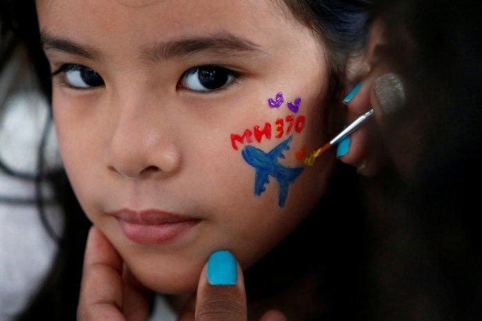 A girl gets her face painted during the fourth annual remembrance event for the missing Malaysia Airlines flight MH370, in Kuala Lumpur, Malaysia March 3, 2018. REUTERS/Lai Seng Sin