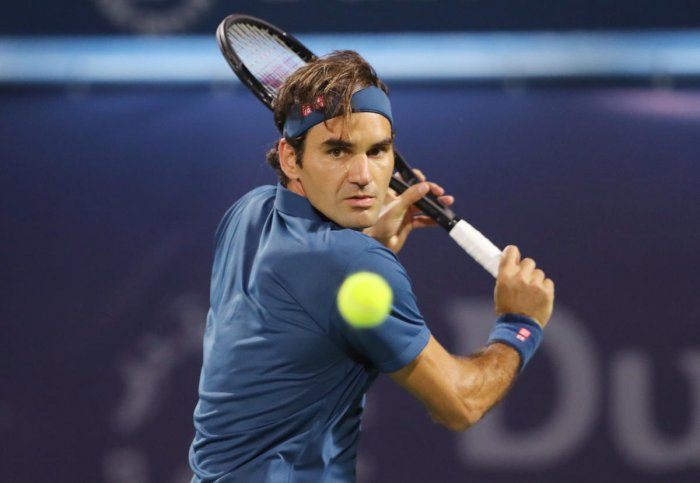 Switzerland's Roger Federer returns during his win over Croatia's Borna Coric. REUTERS