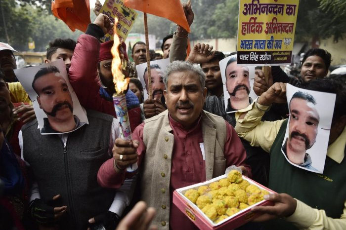 BJP workers celebrate the return of Indian Air Force Wing Commander Abhinandan Varthaman, who was captured by Pakistan during aerial combat, in New Delhi on Saturday. (PTI Photo)