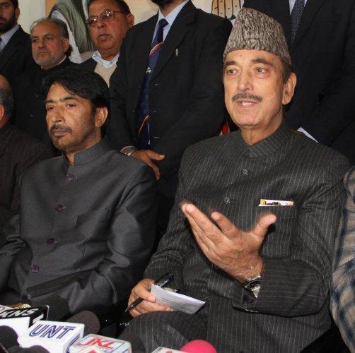 Senior Congress leader Ghulam Nabi Azad and JKPCC President GA Mir at a press conference, in Jammu on Saturday. (PTI Photo)
