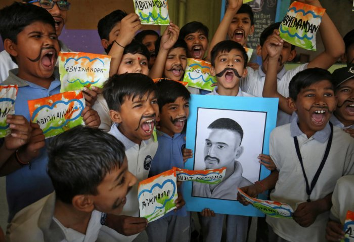 School children react as they celebrate the release of Indian Air Force pilot Wing Commander Abhinandan Varthaman by Pakistan on Friday, during a ceremony inside a school in Ahmedabad, India, March 2, 2019. (REUTERS)