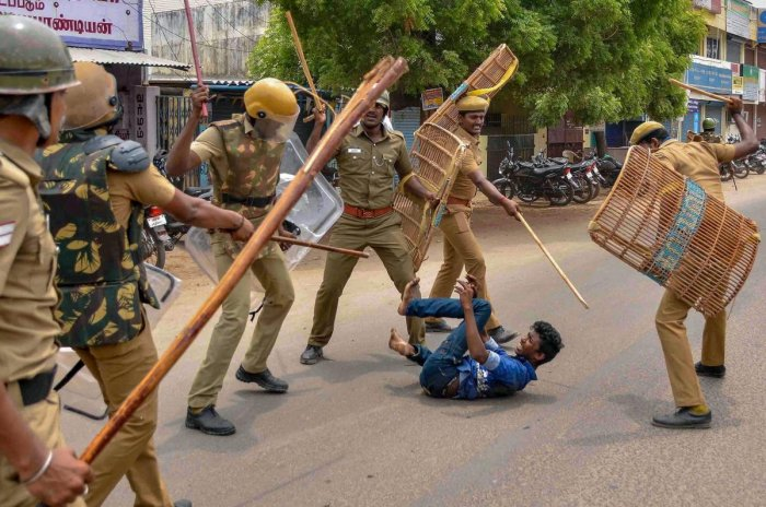 Police personnel baton charge at a protestor demanding the closure of Vedanta's Sterlite Copper unit, in Tuticorin, on Wednesday. In fresh violence today, one person was killed during the clash, after police's open fire killing at least ten people yesterd
