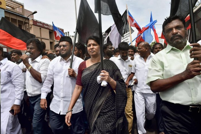 DMK MP Kanimozhi, VCK leader Thol Thirumavalavan participate in a dawn-to-dusk bandh, condemning the police action against protesters in Tuticorin, in which 11 people lost their lives, in Chennai, on Friday. PTI Photo