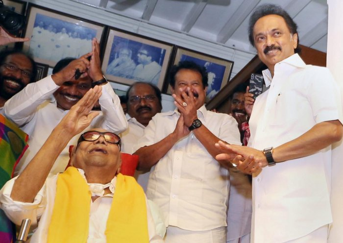 DMK Supremo M Karunanidhi meets his party workers on his 95th birthday outside his residence, in Chennai on Sunday, June 03, 2018. DMK Working President MK Stalin is also seen. (PTI File Photo)