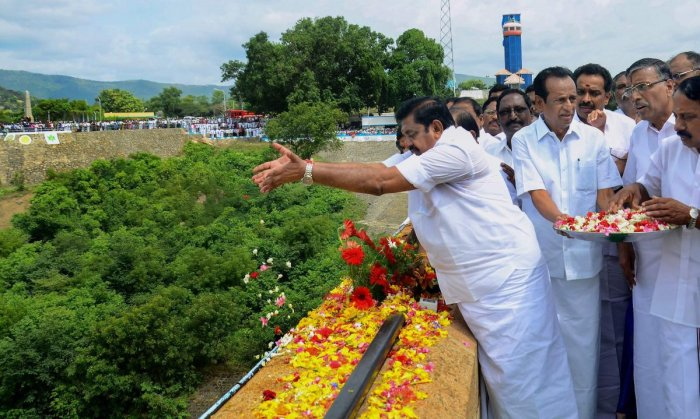 Tamil Nadu Chief Minister Edappadi K Palaniswami opens the sluice gate of Mettur dam to release disputed-river Cauvery water, in Salem on Thursday. (PTI Photo)