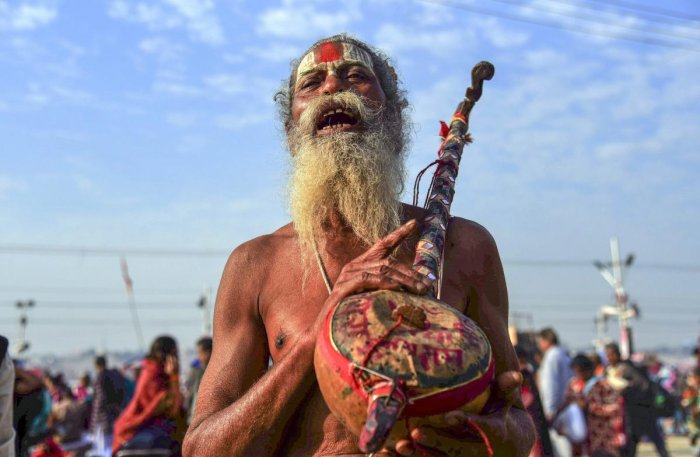 Allahabad: A sadhu chants hymns after taking a holy dip at Sangam on the auspicious 'Maghi Purnima' day during the Kumbh Mela, or pitcher festival, in Allahabad (Prayagraj), Tuesday, Feb. 19, 2019. (PTI Photo) (PTI2_19_2019_000021B)