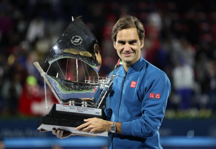 Switzerland's Roger Federer with the Dubai Tennis Championship Trophy after beating Greece's Stefanos Tsitsipas in the final on Saturday. REUTERS