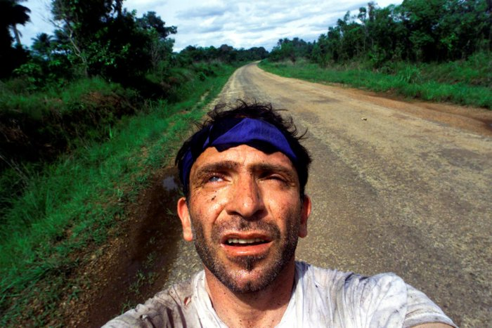 """FILE PHOTO: Yannis Behrakis takes a self portrait after surviving an ambush by Revolutionary United Front rebels in the jungle of Sierra Leone when Kurt Schork and Miguel Moreno were killed, May 2000. REUTERS/Yannis Behrakis/File photo SEARCH """"YANNIS BEHR"""