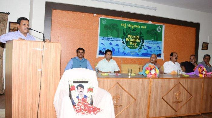 Additional Principal Chief Conservator of Forests B P Ravi speaks during the World Wildlife Day programme at Aranya Bhavan in Mysuru on Sunday. APCCF Jagath Ram, Chief Forest Conservator Ambadi Madhav, DCFs C Siddramappa and K C Prashanth Kumar, wildlife