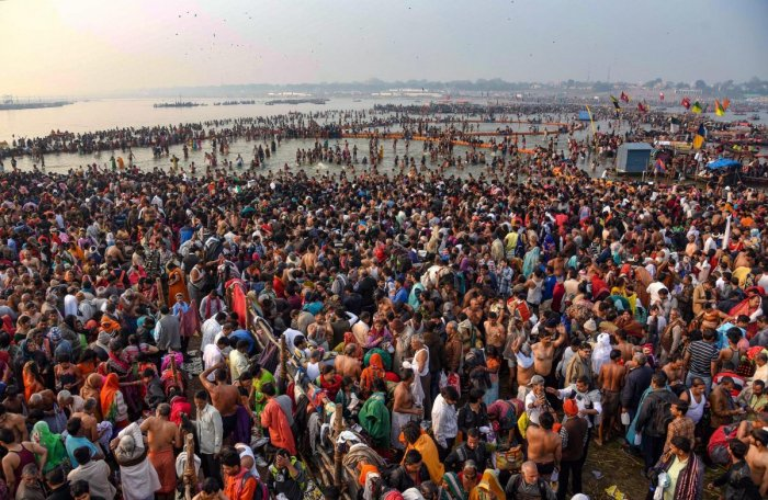 Devotees offer prayer and take holy dip on the occasion of 'Maha Shivaratri' festival during the ongoing Kumbh Mela, in Prayagraj (Allahabad), Monday, March 4, 2019. (PTI Photo)