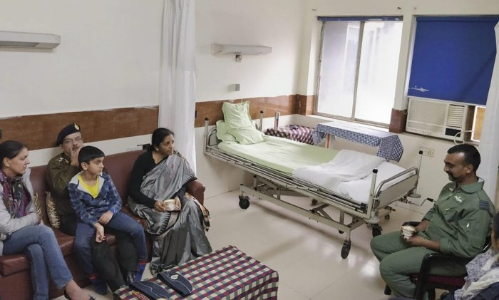 New Delhi: Union Defence Minister Nirmala Sitharaman meets Indian Air Force Wing Commander Abhinandan Varthaman at Army's R.R. hospital, who was captured by Pakistan during an aerial combat, in New Delhi, Saturday, March 2, 2019. (PTI Photo) (PTI3_2_2019_