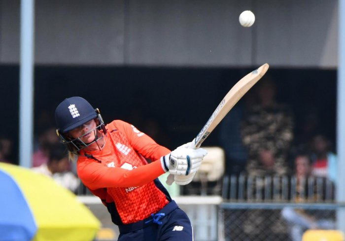 England's Danielle Wyatt plays a shot during the first match of the women's Twenty20 series between India and England at the Barsapara Cricket Stadium in Guwahati. (AFP Photo)