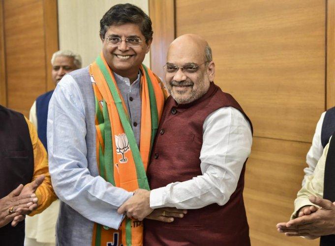 Former Biju Janata Dal MP Baijayant Jay Panda greets BJP national president Amit Shah after joining the saffron party, in New Delhi, on Monday. PTI