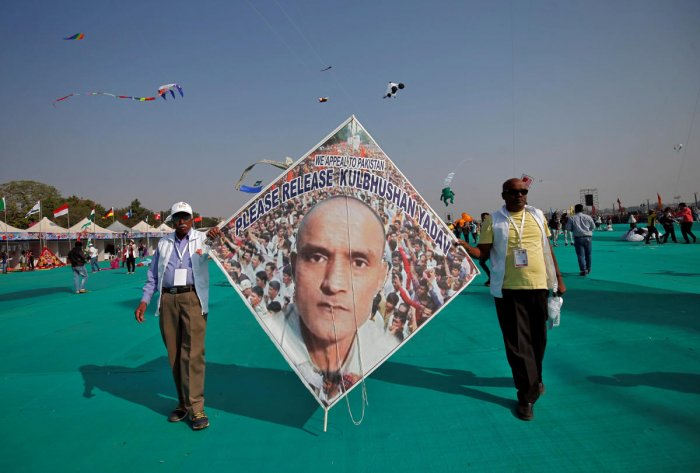 Kite-flying enthusiasts display a kite with an image of jailed Kulbhushan Sudhir Jadhav, a former officer in the Indian navy, who was arrested in the Pakistani province of Baluchistan, in Ahmedabad. REUTERS