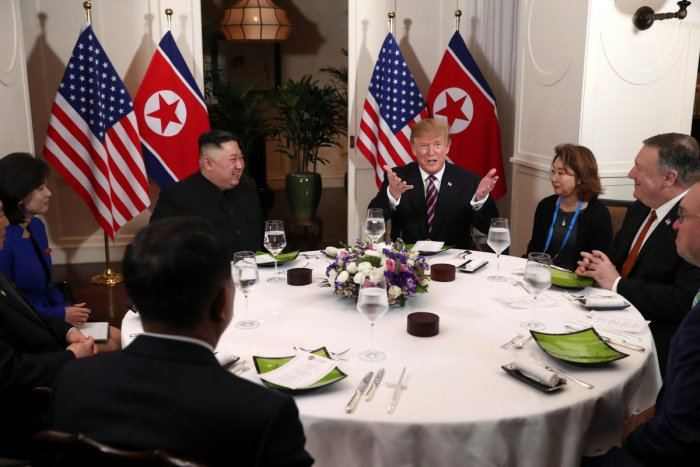 U.S. President Donald Trump and North Korean leader Kim Jong Un sit down for a dinner during the second U.S.-North Korea summit at the Metropole Hotel in Hanoi, Vietnam February 27, 2019. Also pictured at right are U.S. Secretary of State Mike Pompeo and