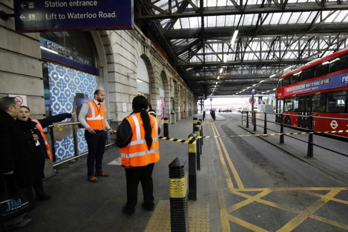 Security personel stand guard outside a police cordon at Waterloo Station, central London. AFP