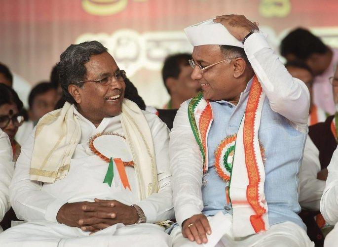 Former chief minister Siddaramaiah and KPCC chief Dinesh Gundu Rao. PTI file photo.