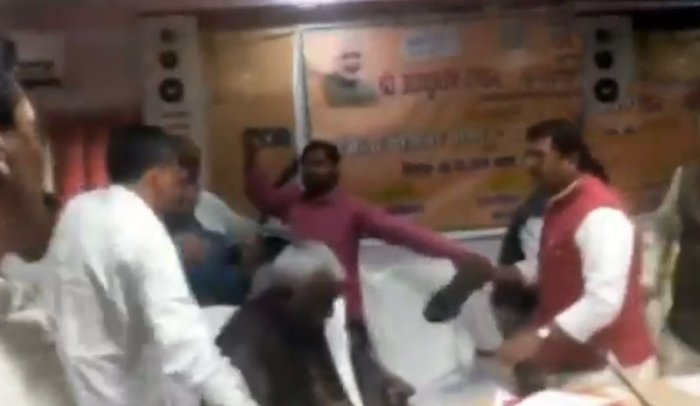 A video, that went viral on the social networking sites, showed Tripathi hitting Baghel with his shoe repeatedly. Baghel was also seen slapping the MP. (screengrab)