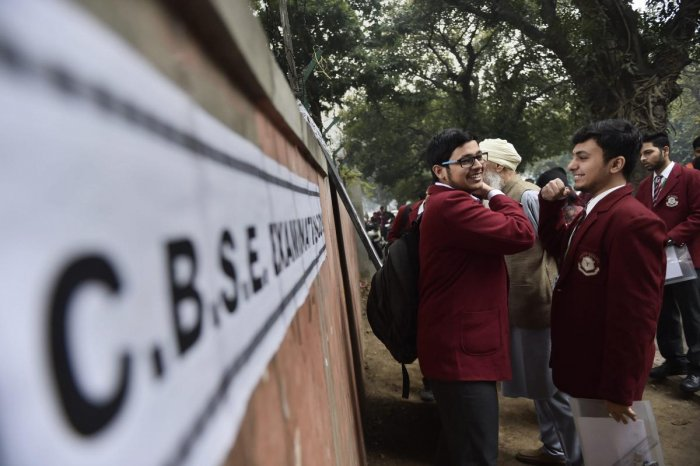 Class 12 students wait outside their exam hall ahead of the first main paper of Central Board of Secondary Education (CBSE) Board paper, in New Delhi on March 2, 2019. (PTI Photo)