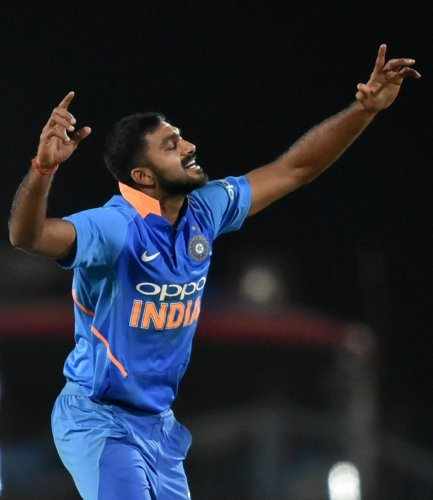 India's Vijay Shankar celebrates after dismissing of Australia's Marcus Stoinis in their second ODI in Nagpur on Tuesday. PTI