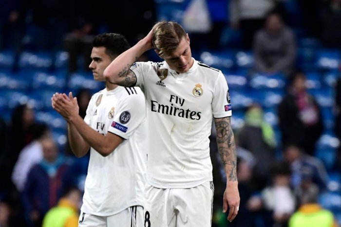 Real Madrid's German midfielder Toni Kroos (R) and Real Madrid's Spanish defender Sergio Reguilon react at the end of the UEFA Champions League round of 16 second leg football match between Real Madrid CF and Ajax at the Santiago Bernabeu stadium in Madri