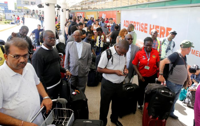 Passengers gather to be screened for check-in at Jomo Kenyatta International Airport during a labour dispute that grounded flights, on the outskirts of Nairobi, Kenya. (Reuters Photo)