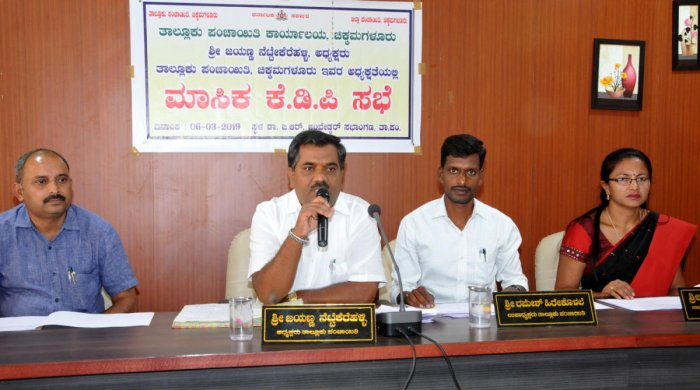 Taluk Panchayat President Jayanna speaks at the monthly review meeting in Chikkamagaluru on Wednesday.