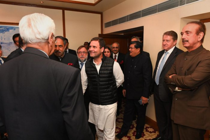 Congress President Rahul Gandhi greets the Ambassadors/High Commissioners of G-20 and neighbouring countries, during a meeting in New Delhi. PTI