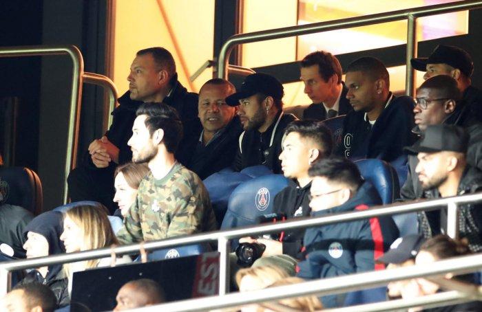 Paris St Germain's Neymar sat alongside Neymar Santos Sr in the stands during the match. (REUTERS)