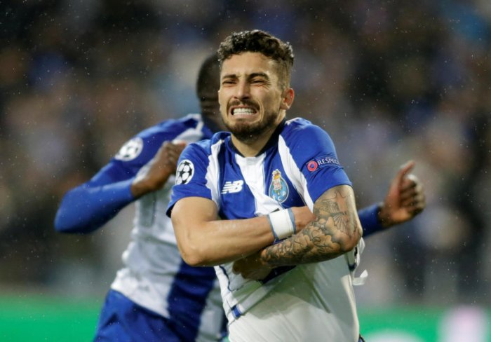 THRILLING END: Porto's Alex Telles celebrates after converting the decisive penalty against AS Roma. Reuters