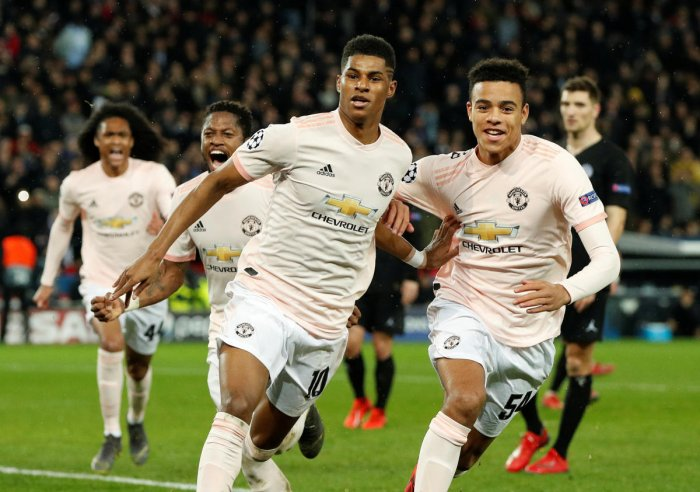 Manchester United's Marcus Rashford celebrates scoring their third goal with Mason Greenwood and Fred. (Reuters)